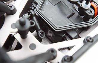 The waterproof steering servo mounts underneath the radio box