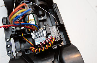 A Tamiya TBLE-02S esc is included. The Futaba receiver is not.