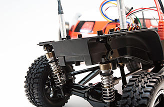 The optional Tamiya long-travel rear suspension kit installed
