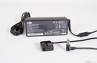 The included charger for flight batteries and the C1 transmitter. It outputs 26.3v at 100w