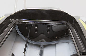 The running gear attaches to the transom through this plastic insert