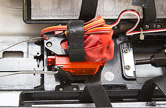 The waterproof, high-torque steering servo and receiver mounted on top