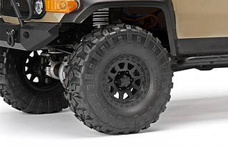 1.9″ CR-10 multi-spoke beadlock wheels and Rockthorn all-terrain soft compound tires with chunky tread blocks.