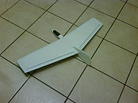 Name: IMG00419-20110519-2104.jpg Views: 109 Size: 57.7 KB Description: Ailerons cut out, bottom hinge was filed down to the peel-ply.