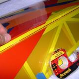 Applying Scotch MultiTask tape to wing side of hinge gap