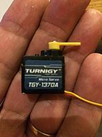 Name: 558DCF7E-A7E0-4512-B78C-E07BB9A64066.jpg Views: 51 Size: 2.42 MB Description: This tiny 4g servo was around $4.00.  Very light, fits, and came with an arm that looks just right.  TGY-1370A