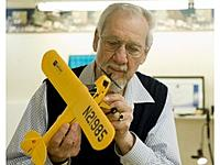 """Name: m06eib-b78922567z_120120229142647000gam15mf4q_1.jpg Views: 99 Size: 14.1 KB Description: Inventor Al Ladine, 83, examines one of his airplane models in the """"man cave"""" at the Atria Woodbridge senior living community in Irvine. Ladine and his friends were building models in a small arts and crafts room at Atria Woodbridge but the wome"""