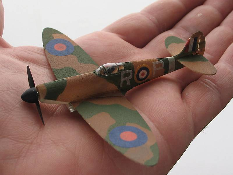 Name: a878003-254-Spit4in1.jpg Views: 1,305 Size: 41.3 KB Description: 4in span Spitfire   1.2g  Durobatics foam. Acrylic paint. Tissue decals. Balsa spinner.  2 channel rud/throttle receiver IRXA261 Tanaka motor Shicoh 3.2mm DD prop 1.1 x.7in (25x16mm) basswood  actuator coil 1.6mmID 154ohm magnet 1 x.5mm N50 batt