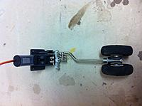 """Name: IMG_1222.jpg Views: 98 Size: 175.9 KB Description: I had an extra set of modified LG wire where the wire is bent to be centered with the gear assembly. The wheel mount is 5/32"""" from Dubro."""