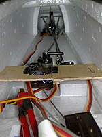 Name: 29042010297.jpg Views: 394 Size: 66.9 KB Description: retract servo mounted on plywood beneath the canopy for easy access