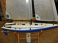 Name: 102_0163 (2).jpg Views: 107 Size: 245.6 KB Description: No port holes - simple accent stripe to highlight the boats lines. Many full size sloops don't have port holes.