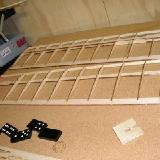 – Leading edge being glued in place.  Note dominoes, handy little right angles!