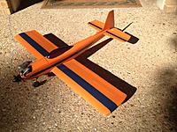 Name: IMG_0965.jpg Views: 279 Size: 87.5 KB Description: The Flea Fli - Balsa fuselage & foam wing, all covered with orange tissue & painted with Nelson Paint.  Wing stripe is Monokote trim with edges sealed with Nelson clear.  Fuselage stripe is masked with Frog Tape.  Nelson paint applied with a foam