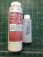 Name: IMG_0973.jpg Views: 140 Size: 58.9 KB Description: Nelson water based epoxy primer & activator.  Can be brushed or sprayed over epoxy & polyester resins and plastics.  It is white with just a hint of gray.  I apply it with a foam brush.