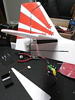 Name: IMG_20170805_050857 - Copy.jpg Views: 25 Size: 250.9 KB Description: Cut a slot in the tail side panel about an inch long for the rods to pass thru to the control surfaces.