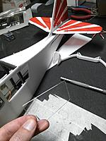 Name: IMG_20170805_210418.jpg Views: 30 Size: 382.9 KB Description: Trim the side panels with the lip extending about 2-3mm around the edges, and insert into the opening in the side of the fuselage. The openings that I cut into the fuse were a little small from the templates, maybe use the windows to trace instead.