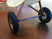 Name: IMG_0354.jpg Views: 195 Size: 53.7 KB Description: Carbon fiber axle secured with thread and a drop of Ambroid.