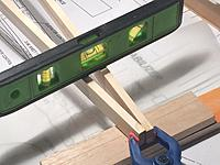 Name: from mobile device 1342.jpg Views: 180 Size: 343.5 KB Description: clamping the rear of the 2 main fuselage sticks together in preparation for gluing