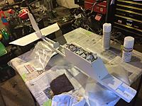 Name: from mobile device 1499.jpg Views: 237 Size: 604.3 KB Description: the fuselage getting painted (CA hinges on stabilizer and fin were installed prior to paint, as well as the locating and drilling of control horns)