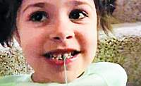 Name: 22.jpg Views: 323 Size: 46.7 KB Description: Ready? A piece of string is tied around the little girl's wobbly tooth...