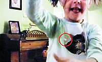 Name: W020091203278913233557.jpg Views: 221 Size: 48.2 KB Description: Showing off: She holds up her tooth - still attached to the string - for the camera