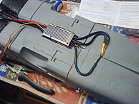 Name: DSC00323.jpg Views: 71 Size: 94.8 KB Description: ...as you can see here.  The TURNIGY ESC is an 85A unit so plenty of headroom.  The cables take thissnaking route because I am reluctant to shorten them dor 2 reasons: 1. soldering 10 AWG cable can be a bit hit-and-miss. 2.  I may want the ESC / Fan for a
