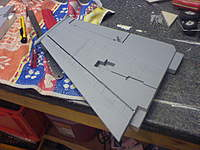 Name: DSC00315.jpg Views: 76 Size: 96.7 KB Description: 3mm carbon rods fitted to the wings ahead of the CofP to induce washout at speed.  Given my time again, i'd have fitted these rods once the wings were fitted to the fuz in order to run the rod partly in to the fuselage.