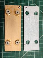 Name: IMG_0465.jpg Views: 5 Size: 809.2 KB Description: Ply underside with nuts epoxied, and foam with cutouts for the nuts.