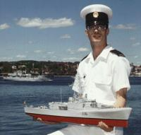 Name: My large picture.jpg Views: 275 Size: 61.5 KB Description: Oh. And as the topic of military uniforms came up. This is a VERY old picture of me when I was still in the Canadian Navy. I served 10 years and am a gulf war veteran. And yes, I scratch built that model I'm holding too.