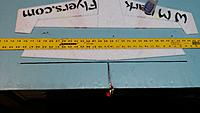 Name: 20150112_212609[1].jpg Views: 138 Size: 381.3 KB Description: Using a straight edge as a fence, glue the leading edge carbon to the front of the wing. Use pins to hold the carbon tight to the wing and against the straight edge. I like to use a small hemostat to hold the carbon while applying glue.