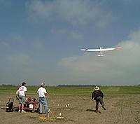 """Name: Dudley launching.jpg Views: 71 Size: 72.4 KB Description: Dudley and Peter Jr.   launching """"Good-n-Plenty""""  (SBXC).     Unfortunately I destroyed her the following year at Montague"""