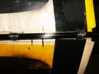 Name: wingmount.jpg Views: 138 Size: 93.1 KB Description: Doug had mounted the wing on standard posts with screws.  I couldn't do that with my boom, so I threaded some CF tow in the holes and around the boom with CA
