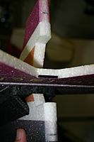 Name: IMG_6787.jpg Views: 327 Size: 70.8 KB Description: Using the hinges in the rudder as a guide, mark for the hinge slots in the fuselage.  Warning:  I put my top hinge in too high and had to change it.  Install top hinge no higher than the purple line in the scheme.