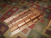 Name: 100_0141.jpg Views: 64 Size: 237.9 KB Description: first coat of poly, gonna use 2 just ta make shure I don't miss any spots! after looking at the bigger boats build threads, would you guys recomend adding floatation in the framework?