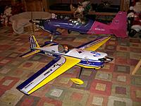 Name: 100_0159.jpg Views: 103 Size: 244.9 KB Description: what's new, carbonfiber landing gear, aluminum spinner, and now she has a pilot for control! looking pretty sharp in front of her big sis!