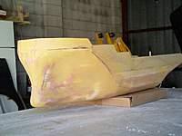 Name: Tug0009.jpg Views: 242 Size: 32.9 KB Description: hull sanded and light primer/surfacer coat 2 show high/low spots