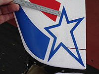 """Name: 029.JPG Views: 33 Size: 1.06 MB Description: The outer rear corner of the star goes about 1/8"""" from the wing corner and the inner rear tip is about 1/8"""" from the T.E.   The forward edge of the blue is about 5/16"""" back from the L.E."""