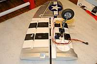 Name: P-47 Thunderbolt_Build_Wing-Spar_Mod_DrillBit_12-11-2010_0002.jpg Views: 357 Size: 62.6 KB Description: I then inserted the entire assembly in the spar channel, running it thru the 2 spar clamps to assure a straight and perfect alignment.   Hooked up the drill and slowly drilled the hole extension.