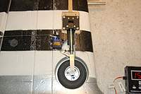 """Name: P-47 Thunderbolt_Build_LandingGear_Mod_2-13-2011_0002.jpg Views: 228 Size: 71.1 KB Description: *UP-DATE 2/13/2011*  The starboard set-up with the 2 3/4"""" Goodyears."""