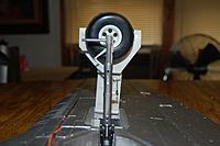 Name: Sandancer_RCSkyLite_T-28-Struts_6-25-2011_0001.jpg Views: 344 Size: 190.4 KB Description: Weighing 1.1 oz. the RCSL are .2 oz lighter then the P-40 VQ.
