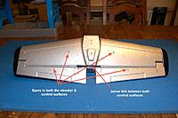 Name: Sandancer_FMS 1400 P-51 BBD-UnBoxing_12-28-2012_0031.jpg Views: 252 Size: 297.4 KB Description: The horizontal stab with all the pre-installed spars.  Note the control surface joiner, one control link is all that is needed now.