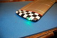Name: Sandancer_FMS 1400 P-51 BBD-UnBoxing_12-28-2012_0058.jpg Views: 193 Size: 266.7 KB Description: Starboard Nav Light.