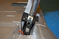 Name: Sandancer_FMS 1400 P-51 BBD-UnBoxing_12-28-2012_0066.jpg Views: 235 Size: 167.6 KB Description: The PZ-312 w/metal (aluminum) trunnion.