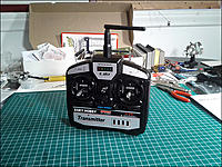 Name: HBCPX_Tx_Front.jpg Views: 256 Size: 161.2 KB Description: Front of the included transmitter. The Tx has a hook for a neck strap but no strap is included in the box. A row of LEDs indicates power level.