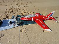 Name: Hawk trainer in sandy pit.jpg Views: 15 Size: 636.1 KB Description: In the sandy pit.