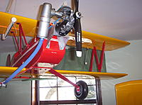 """Name: Building Biplane2 039.jpg Views: 111 Size: 1.04 MB Description: It is real tail heavy so I made a 3"""" engine mount extention out of .032 2024 T3 The cabine struts are made out of 1/8"""" 6061. It hangs from the ceiling on PVC pipe there are penciles between the wings and the pipe to determin the ballance point."""