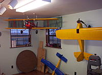 Name: Building Biplane2 040.jpg Views: 78 Size: 1.12 MB Description: My three R/C planes at that time. The yellow bird I crashed and I had to build a replacment. The new one was hit by radio interference this summer so I bought a 2.4G radio I hope that don't happen agin.