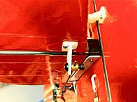 Name: photo 5.jpg Views: 115 Size: 77.9 KB Description: Carbon rod is also attached to the stick with a strap of thin plastic. This greatly stiffens the rudder. Notice all the Bubro Linkage. A must :)
