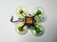Name: 20171206_200830_resized.jpg Views: 25 Size: 418.0 KB Description: Tiny Whoop #1 (Green & Yellow Props)