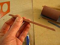 Name: 86784.jpg Views: 43 Size: 411.5 KB Description: This is how I cut out spar groove. Sandpaper ribbon glued on a piece of spar